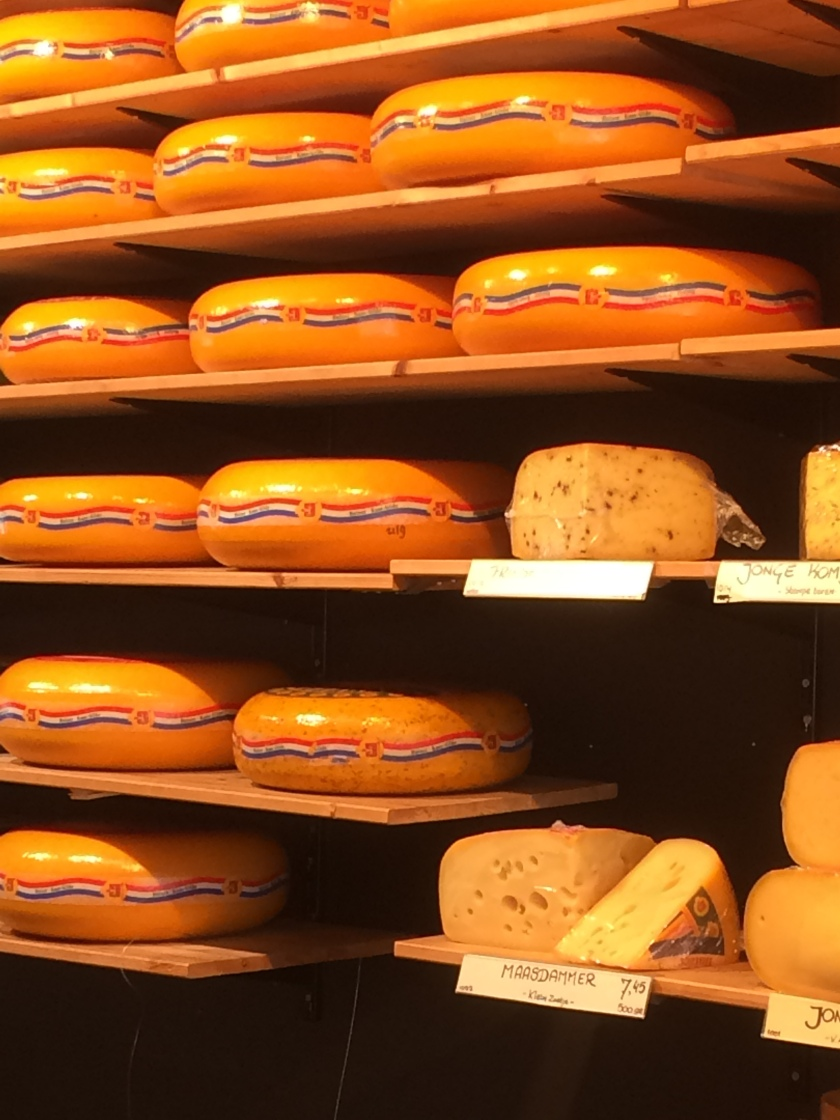 Dutch cheese lines a shelf.